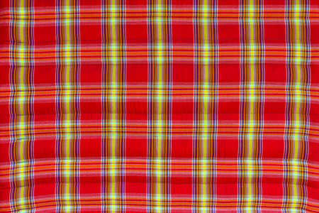 upholster: Close up background of a soft mattress fabrics, with red and yellow stripes pattern beautiful Thailand.