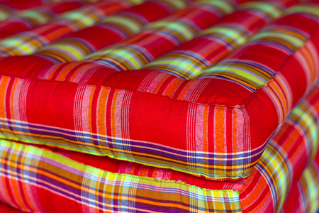upholster: Close angles mattresses stuffed cloth pattern red yellow spot focus and the background blurred.