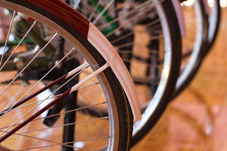 fender: Close spokes of a bicycle wheel and fender park lined with ancient tiles on the floor. Stock Photo