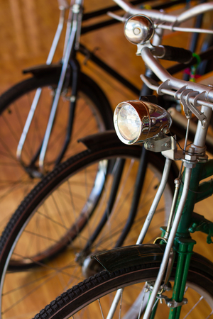 Close up of a vintage bicycle bell and lantern lights, modified, reused, re-park it in a museum.