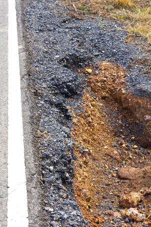 earlier: Potholes, gravel beside the road collapsed from water erosion, which runs through earlier.
