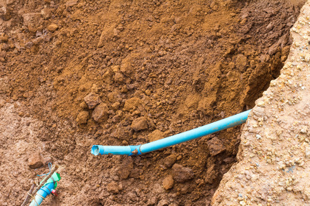 sandy soil: Above a pile of sandy soil slides down deposits due to accidents, broken water pipes.