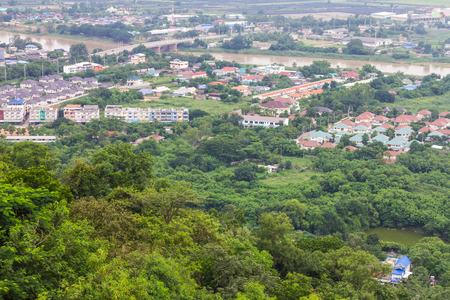 residential housing: View high above the residential housing buildings which have rivers and forests in the city. Stock Photo