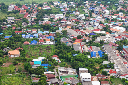 View high above the residential housing buildings which have rivers and forests in the city. Stock Photo