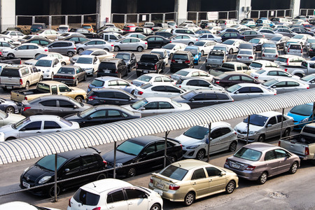 parking facilities: BANGKOK THAILAND-JUNE 19: View above the parking lot where cars are parked everywhere across the Chatuchak Park.On June 19, 2015 in Bangkok,  Thailand.