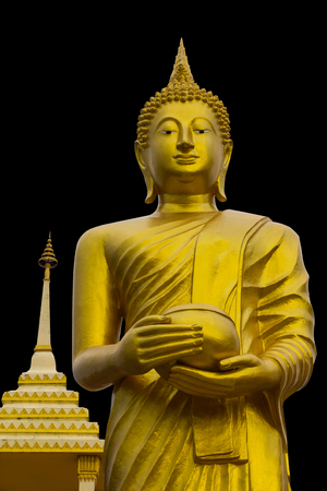isolates: Isolates from a low of golden Buddha which stands gracefully waiting for alms near a pagoda. Stock Photo