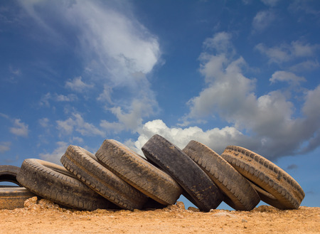 tire: Row wheel tire wear, and then placed on the ground, cloudy sky and a beautiful backdrop.