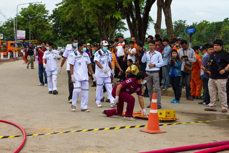 planned: PHIcHIT THAILAND-AUGUST 7: Crowds are training sessions planned road accidents are the firefighters, rescue and photographers.On August 7, 2015 in  Phichit, Thailand.