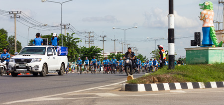 overseeing: PHICHIT THAILAND-AUGUST 9:Car led the procession of cyclists spinning activities for mothers of Thailand, which is overseeing the traffic police.On August 9, 2015 in Phichit, Thailand.