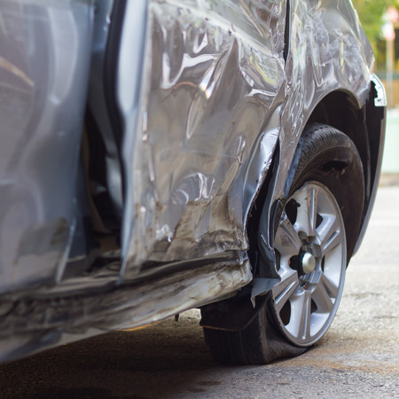 demolished: Close demolished down the side of a car which collided with another vehicle accident, plying dangerous. Stock Photo