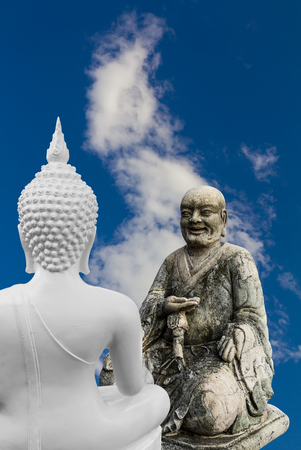 preach: Buddha statues white preach dialogue with the Chinese monks who staged a cloudy sky. Stock Photo