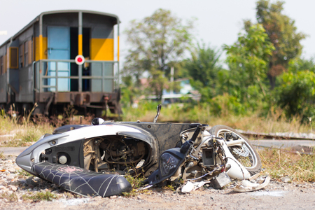 collisions: Close-motorcycle crash which shattered accidental collisions with trains plying on sailing on the track. Stock Photo