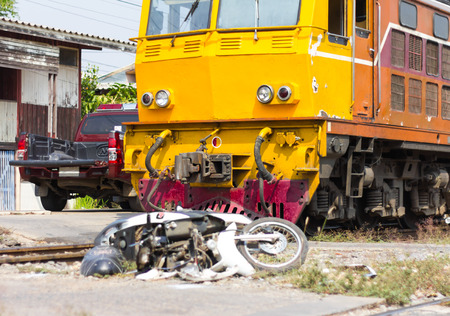 accidental: Close-motorcycle crash which shattered accidental collisions with trains plying on sailing on the track. Stock Photo