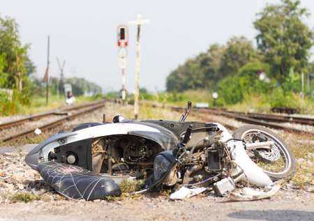 negligence: Motorbike demolished due to the negligence of the driver caused the accident, train collision.