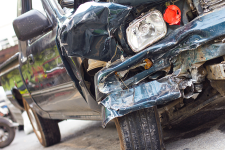 colliding: Side of the car headlights are demolished due to an accident with another vehicle colliding violently. Stock Photo