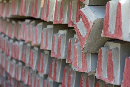 Blur the background and focus close-concrete railway sleepers, which stack as many rows. Stock Photo