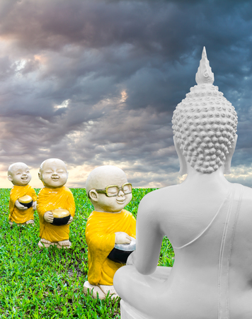absolutely: White Meditating Buddha statues gaze to the monks alms, which was absolutely beaming.