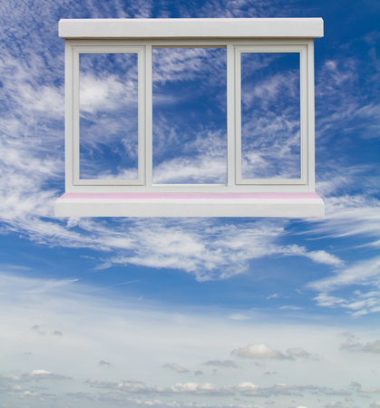 looking through an object: Windows frame beautiful white clouds floating on a blue sky, bright and lonely isolation.