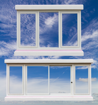 looking through an object: Transom windows white, two different floating on a beautiful blue sky with fluffy white clouds. Stock Photo