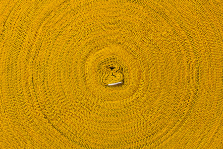 nylon string: Close up, the surface of the roll, which is a yellow rope abstract background beautifully clear.