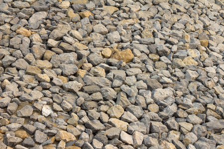 coastal erosion: Background pile of rocks, which placed the tiles without a trace to a barrage of coastal erosion.