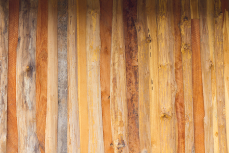 hardwood planks: Background hardwood planks which row vertically to the wall of an old house with a beautiful art. Stock Photo