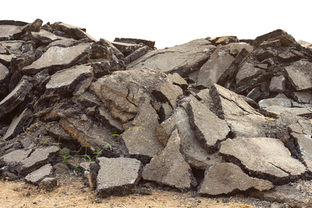 Isolates background ensemble pieces of asphalt road which lay heaped on the ground to be recycled. Stok Fotoğraf