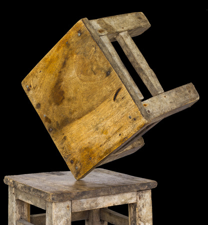 isolates: Isolates two small wooden chairs, which overturned and laid the corner were not unstable equilibrium. Stock Photo