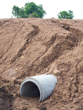 landfills: Close-concrete drainage pipes which were landslides due to heavy rains over landfills. Stock Photo