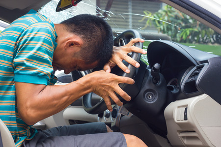 look inside: Man drunk contraction bent and warped look inside his car accident which fractured windshield.