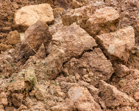 a pile: Large piles of clay, which dropped to the bottom and break apart because of water erosion.