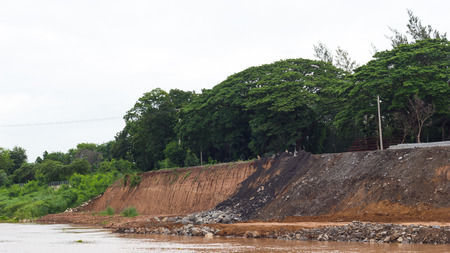 land slide: Land slide alongside the river erosion, which has the stones to ashes with concrete construction.
