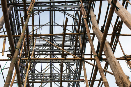rejas de hierro: Close up view of the lower structure of steel and bamboo scaffolding for construction.