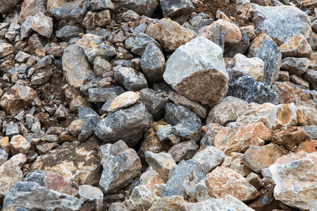 stackable: Background pile of large rocks, which are stackable for preparing construction flap waterproof soil mix. Stock Photo