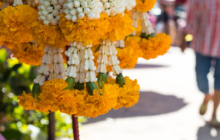 malai: Close marigold garland hanging nicely in the market waiting to be sold in one of Thailand.
