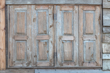 windows and doors: Background old wooden doors, windows, ancient abandoned weathered. Stock Photo