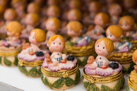 beautifully: Ceramic doll small girl sitting in a row lined up waiting to sell many beautifully.