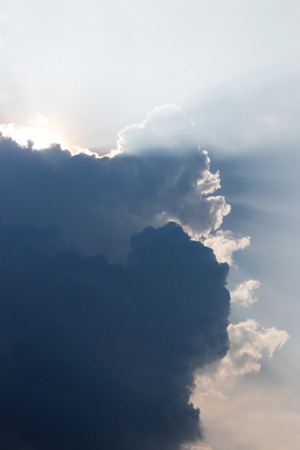 obscured: Background backlit clouds which obscured the sun during the day beautiful and frightening.
