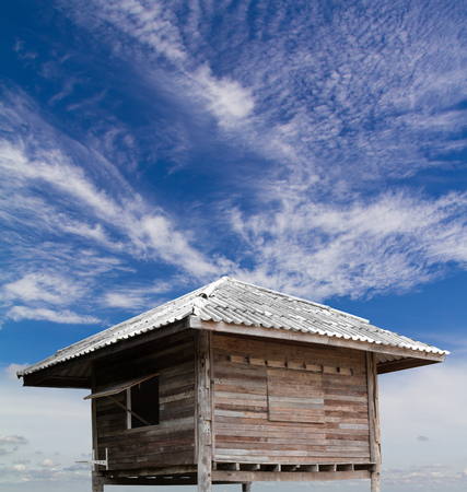 dispersed: Old wooden hut which is reused with clouds dispersed and the sky is a beautiful backdrop.