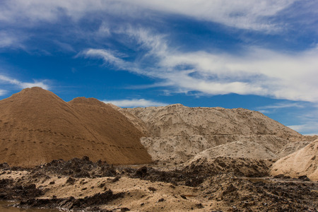 Hill provided the sand used for construction, which traces its feet and the sky as a backdrop. Stock Photo