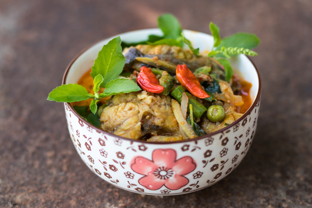 Catfish in curry dishes as delicious food of Thailand, which is placed on the top surface rust.