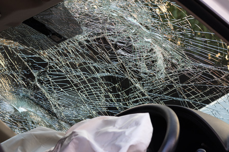 Close-room motorists in an accident severely inflate the airbags and windshield cracked.