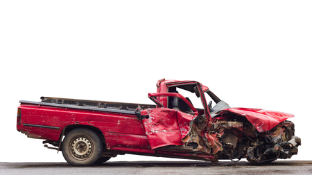 Isolate side of the old red car with front demolished in a serious accident on the road. Stock Photo