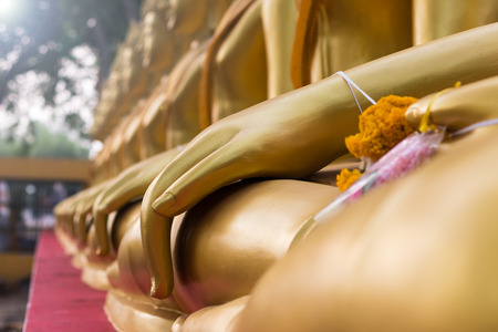 Close-up view of low view of the hands of the Buddha meditated in a beautiful Buddhist pattern. Stock Photo