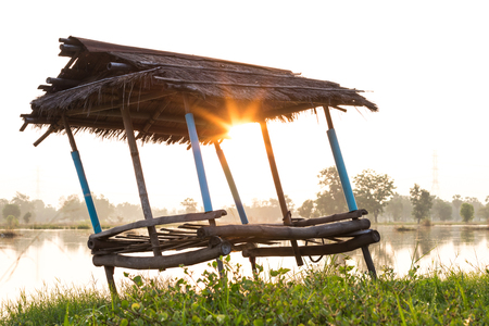 hospedaje: Close-up image of an old bamboo hut with vetiver roof, which has sunrise at dawn. Foto de archivo