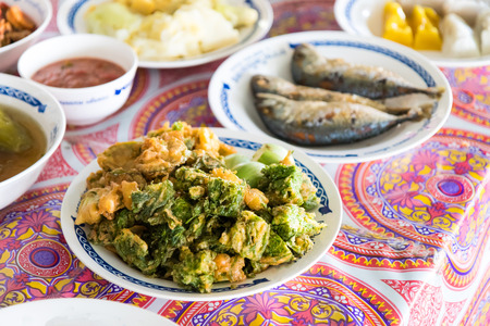 Cha with eggplant and fried fish with chili paste, a popular dish of Thailand.