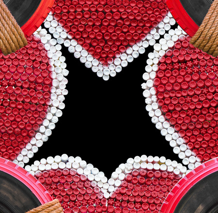 Heart shaped plastic box frame made of red-white plastic bottle with rubber wheel and rope.