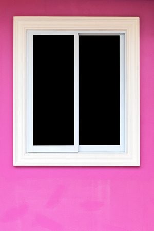 aluminum: Close-up background, concrete window frame and white aluminum have black slots in pink walls. Stock Photo