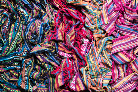 Fabric pieces are woven with a variety of colorful yarns, and the rest of the patchwork is neatly sewn.