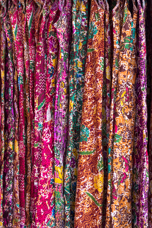 Thai patterned background on clothes hanging for sale, commonly seen in the Thai market.
